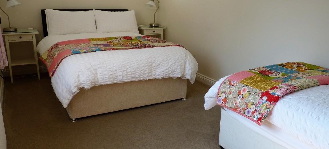Ground floor bedroom with a view of Glastonbury Tor