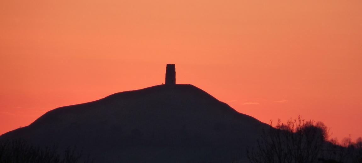 Glastonbury Tor with orange skies
