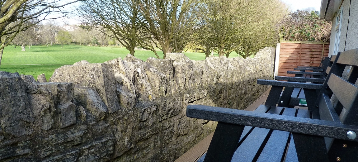 Seating at the rear of No 51 overlooking the Abbey grounds